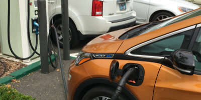 Long Distance EV Travel Aided by Fast Charging Networks